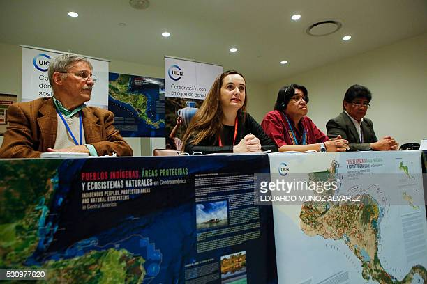 Gretel Aguilar speaks to guests accompanied by Mac Chapin anthropologist Amadeo Martinez President of the Indigenous Council of Central America and...