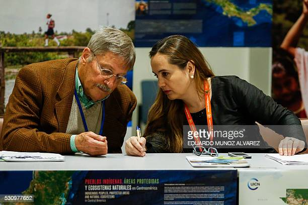 Gretel Aguilar speaks with Mac Chapin anthropologist before a press conference about the new high Indigenous tech map on May 12 at the United Nations...