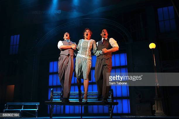 Gretel Scarlett Jack Chambers and Adam Garcia perform during a production media call for Singin' In The Rain at Her Majesty's Theatre on May 12 2016...