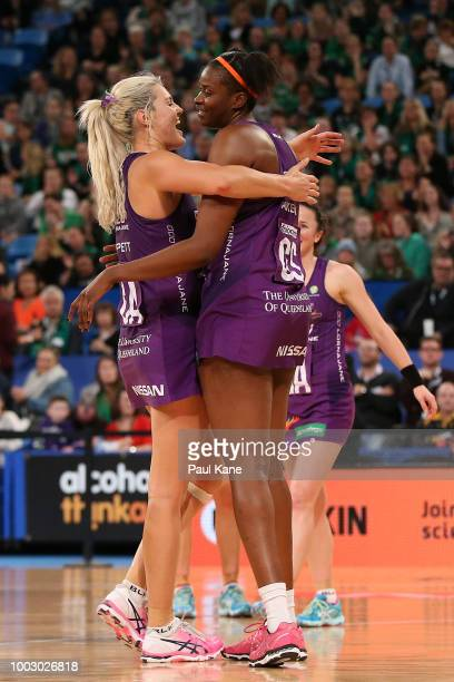Gretel Tippett and Romelda Aiken of the Firebirds celebrate winning the round 12 Super Netball match between the Fever and the Firebirds at Perth...