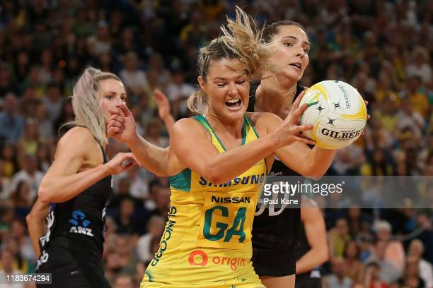 Gretel Tippett of Australia and Karin Burger of New Zealand contest for the ball during the 2019 Constellation Cup match between the Australia...