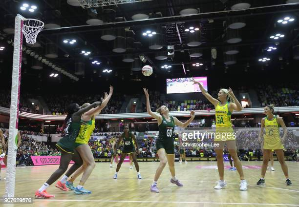 Gretel Tippett of Australia passes to team mate Caitlin Thwaites during the Netball Quad Series Vitality Netball International match between South...