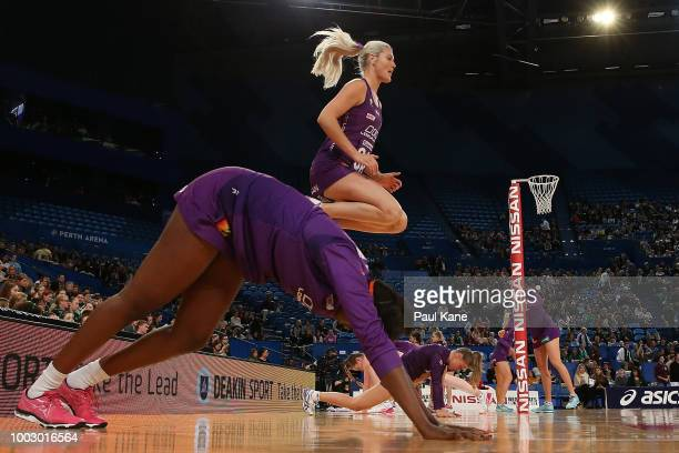 Gretel Tippett of the Firebirds catches a pass against Stacey Francis of the Fever during the round 12 Super Netball match between the Fever and the...