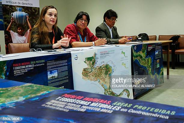 Grethel Aguilar Regional Director of International Union for Conservation of Nature speaks to guests next to Amadeo Martinez President of the...