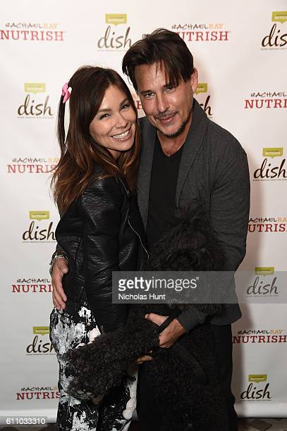 Gretta Monahan and Ricky Paull Goldin attend the celebration of the launch of Rachael Ray's Nutrish DISH with a Puppy Party on September 28, 2016 in...