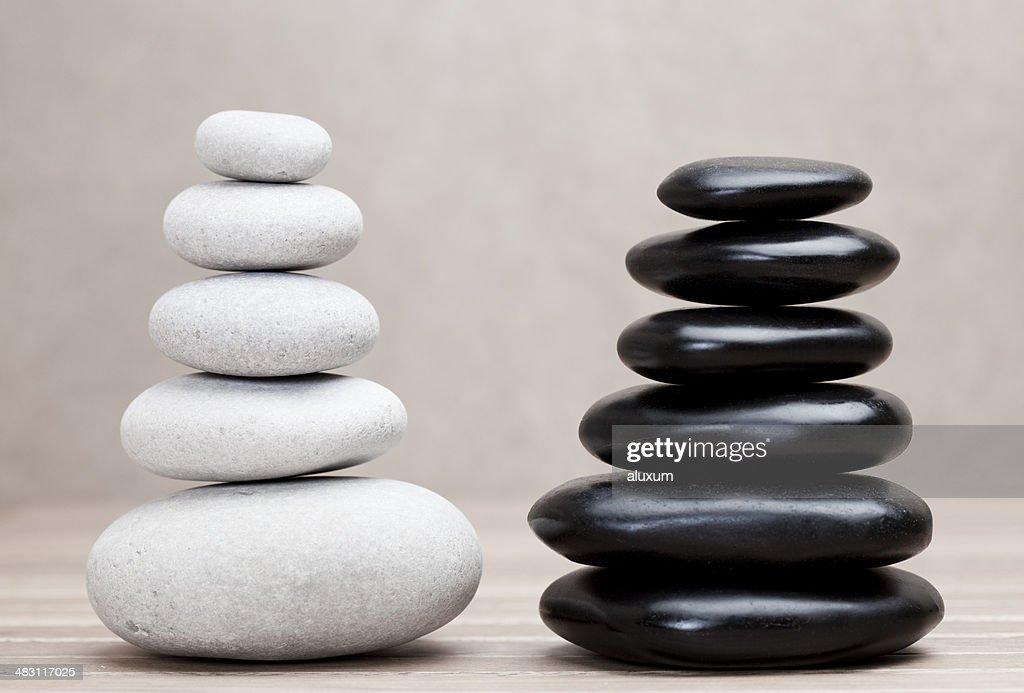 grey and black piled pebble stones : Stock Photo