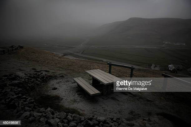 A grey and dark landscape caused by the thick ash cloud spewed by Iceland's Eyjafjallajokull volcano that blacked out visibility under the plume near...