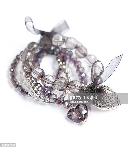 diy grey and silver bracelet set - charm bracelet stock photos and pictures