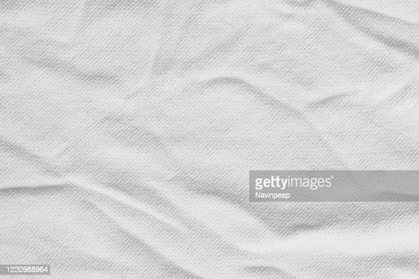 grey crumpled bedsheet - towel stock pictures, royalty-free photos & images