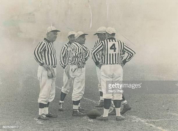 Grey Cup -- but where are the players? Game officials stand alone in the fog at the scene of the zaniest Grey Cup in history. The game was finally...