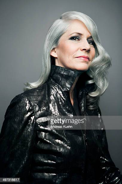 grey haired lady in a stylish jacket, portrait. - waist up stock pictures, royalty-free photos & images