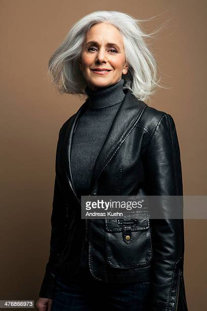 Grey haired mature woman in leather jacket.