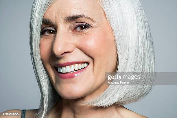 grey haired woman with a big smile, close up. - positive emotion stock pictures, royalty-free photos & images