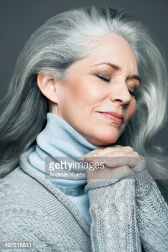 Grey Haired Woman With Her Eyes Close Smiling Stock Photo