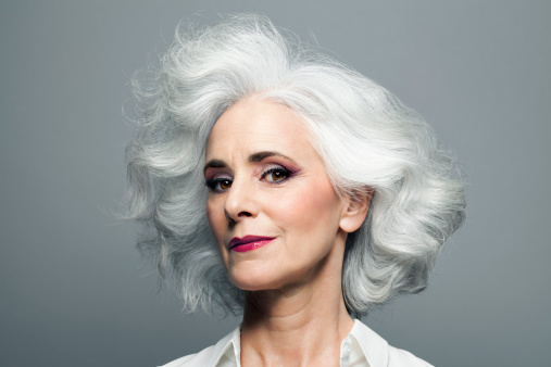 Grey haired woman with red lip stick, portrait. - gettyimageskorea