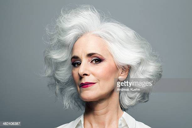grey haired woman with red lip stick, portrait. - pretty older women stock pictures, royalty-free photos & images