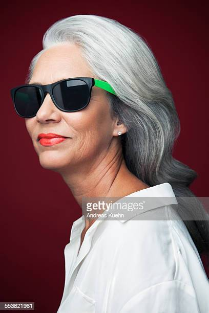 Grey haired woman with sunglasses, portrait.