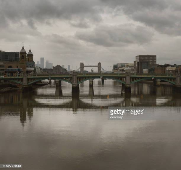 grey london bridge reflections - central london stock pictures, royalty-free photos & images