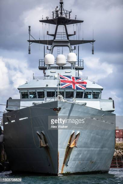 grey navy boat with british flag - falmouth england stock pictures, royalty-free photos & images