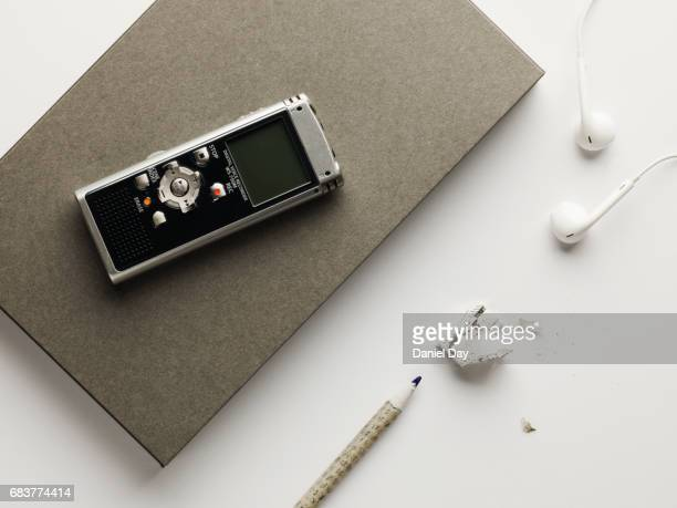 Grey note book and pencil with dictaphone
