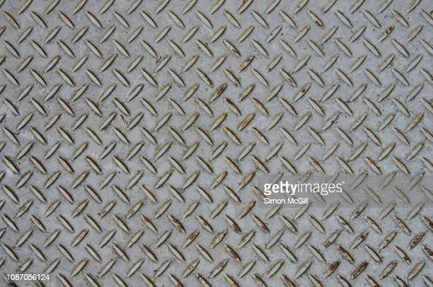 grey painted steel plate with cross-hatch non-slip texture pattern - rusty stock pictures, royalty-free photos & images