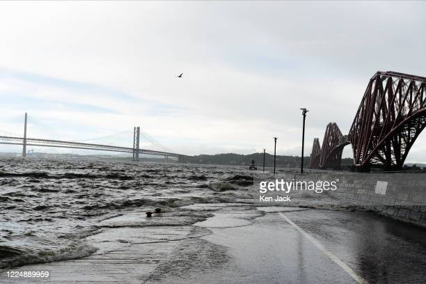 Grey skies and rough seas around the Forth bridges, as parts of Scotland are affected by heavy rain and strong winds, on July 5, 2020 in Edinburgh,...