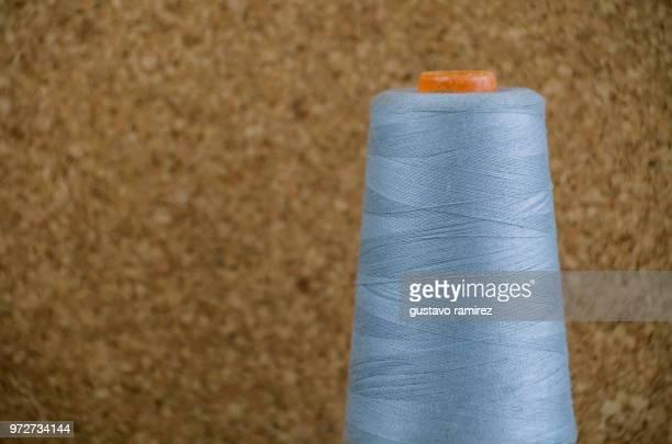 grey spool of thread