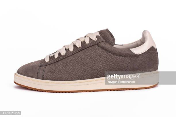 grey suede sneaker shoe on white background - loafers stock pictures, royalty-free photos & images