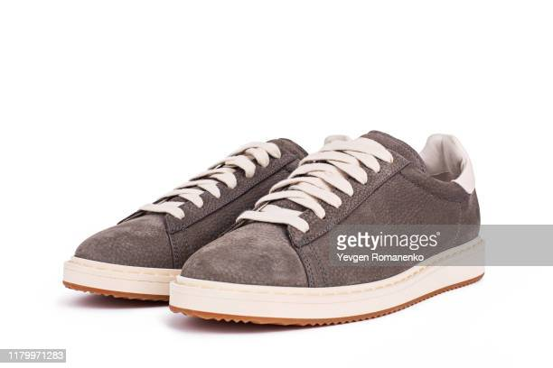 grey suede sneakers shoes on white background - loafers stock pictures, royalty-free photos & images