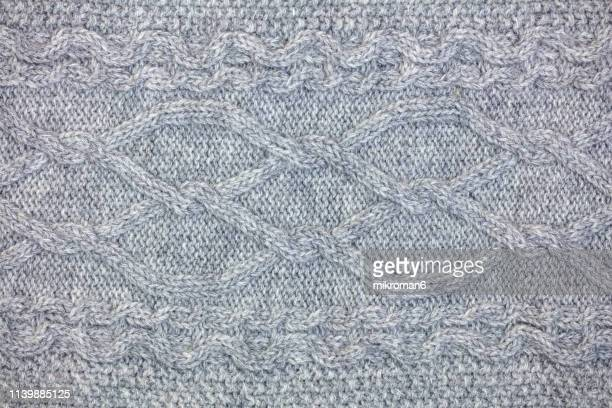 grey sweater background - knitted stock pictures, royalty-free photos & images