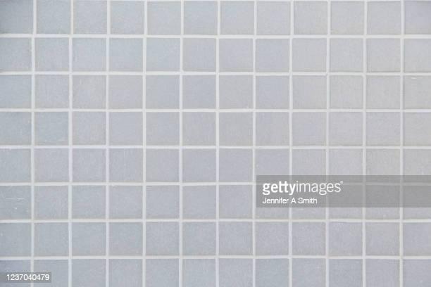 grey tiled wall - タイル張りの床 ストックフォトと画像