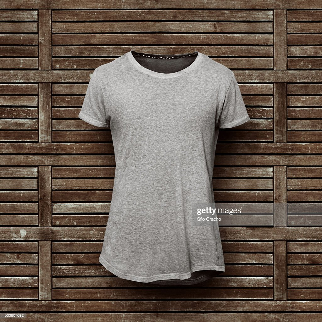 Grey t-shirt isolated on wooden background : Foto stock