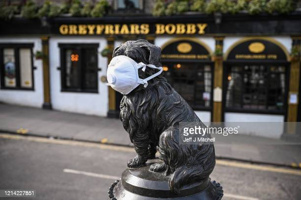 Greyfriars Bobby statue has a mask placed on his face on March 23 2020 in Edinburgh Scotland Coronavirus has spread to at least 188 countries...