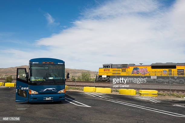 greyhound bus and union pacific railroad - greyhound stock photos and pictures