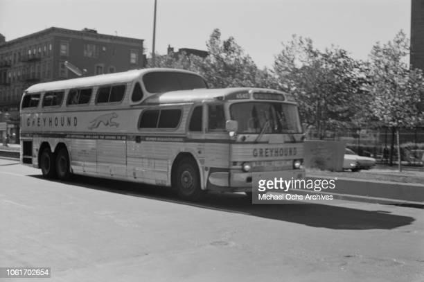A Greyhound Bus arrives in Harlem New York City circa 1968
