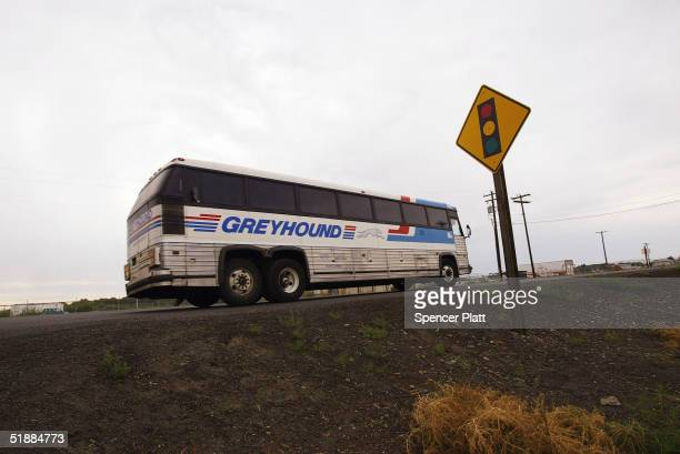 Greyhound bus pulls out of a driveway of a diner in rural Washington state August 16 2004 Greyhound the iconic bus company will stop servicing over...
