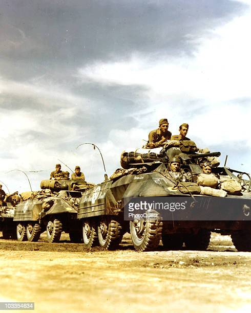 M8 Greyhound tanks of the 36th Division of the 5th Army lined up just before boarding an LST at a port of embarkation in Italy 1944 Men in the front...