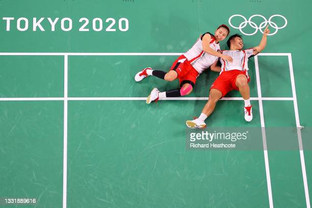 Greysia Polii and Apriyani Rahayu of Team Indonesia celebrate as they win against Chen Qing Chen and Jia Yi Fan of Team China during the Women's...