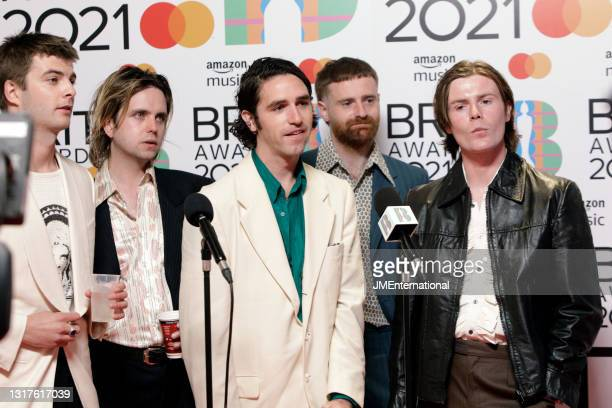 Grian Chatten, Conor Deegan III, Carlos O'Connell, Tom Coll and Conor Curley of Fontaines DC are interviewed in the media room at The BRIT Awards...