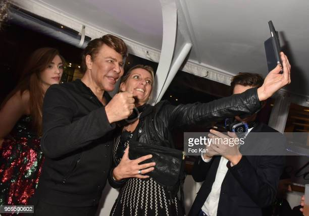 Grichka Bogdanoff and guests attend the Technikart Boat Party during the 71st annual Cannes Film Festival at on May 16 2018 in Cannes France