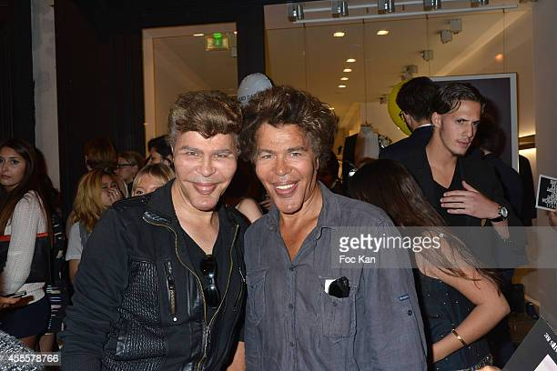 Grichka Bogdanoff and Igor Bogdanoff attend the Vogue Fashion Night Out 2014' In Paris on September 16 2014 in Paris France