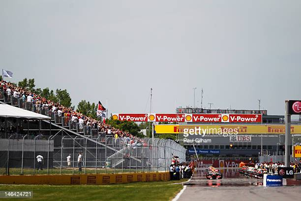 Grid forms up for the warm up lap before the Canadian Formula One Grand Prix at the Circuit Gilles Villeneuve on June 10 2012 in Montreal Canada
