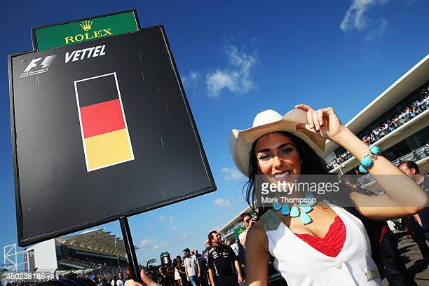 Grid girl for Sebastian Vettel of Germany and Infiniti Red Bull Racing is seen before the United States Formula One Grand Prix at Circuit of The...