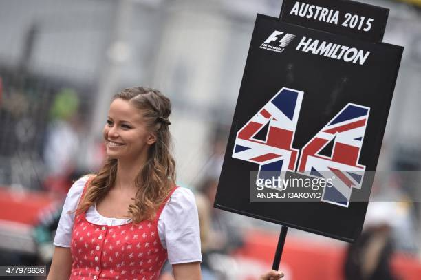 grid-girl-holds-a-sign-with-the-number-4