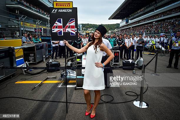 A grid girl holds a sign with the number 44 of Mercedes AMG Petronas F1 Team's British driver Lewis Hamilton prior to the Russian Formula One Grand...