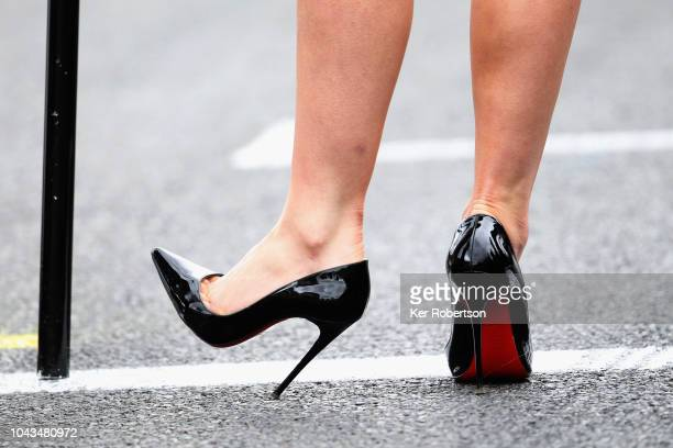 Grid girl in Christian Louboutin shoes before race 2 during the final rounds of the British Touring Car Championship at Brands Hatch on September 30...