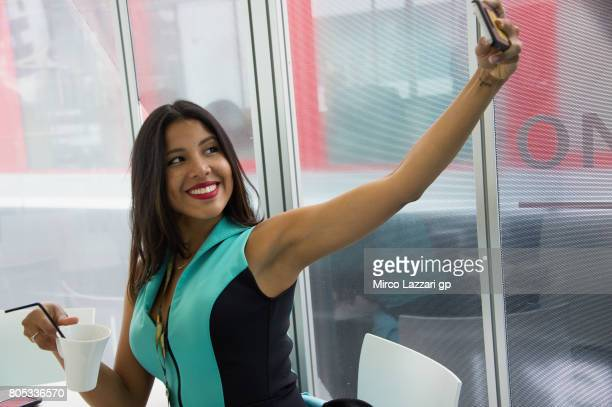 A grid girl makes a selfie during the MotoGp of Germany Qualifying at Sachsenring Circuit on July 1 2017 in HohensteinErnstthal Germany
