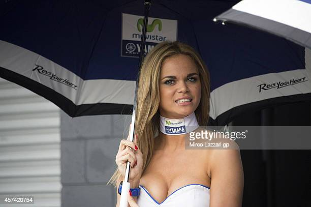 A grid girl poses in paddock during qualifying for the 2014 MotoGP of Australia at Phillip Island Grand Prix Circuit on October 18 2014 in Phillip...