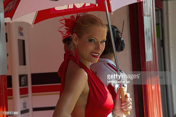 A grid girl poses in the pit during the MotoGp Of Catalunya Free Practice at Circuit de Catalunya on June 14 2013 in Montmelo Spain