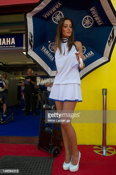 A grid girl poses in the pit during the MotoGP race of the MotoGP of Italy at Mugello Circuit on July 15 2012 in Scarperia Italy